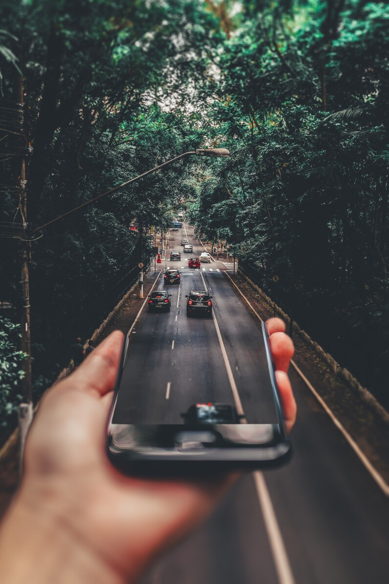 forced perspective photography of cars running on road below 799443